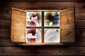 Santa delivers presents against window — Stockfoto