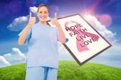Doctor with breast cancer awareness message — Stock Photo