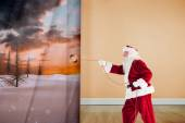 Composite image of santa pulls something with a rope — Stok fotoğraf