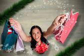 Composite image of woman standing with shopping bags — ストック写真