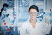 Serious chemist working with white dna helix — Stock Photo