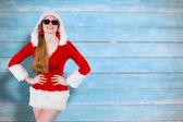 Composite image of cool santa girl wearing sunglasses — Stock Photo