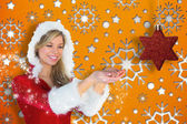 Pretty santa girl holding hands out — Stock Photo