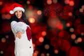 Composite image of woman holding money towards herself — Stock Photo