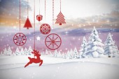 Composite image of hanging red christmas decorations — Stock Photo
