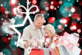Composite image of couple with shopping bags — Stock Photo