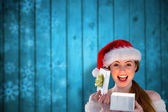 Sexy girl in santa costume opening a gift — Stock Photo
