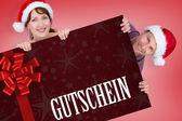 Composite image of couple both wearing santa hats — Stock Photo