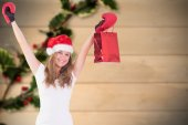 Composite image of festive blonde with boxing gloves and shoppin — Stok fotoğraf
