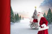 Santa claus pulling a rope — Stock Photo