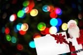 Santa claus showing a card — Stock Photo