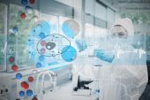 Scientist in protective suit working — Stock Photo