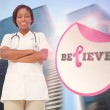 Doctor with breast cancer awareness message — Stock Photo #57160115