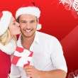 Composite image of young festive couple — Stock Photo #57160123