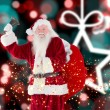 Composite image of santa claus ringing bell — Stock Photo #57160225