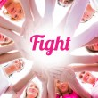 Diverse women smiling in circle wearing pink for breast cancer — Stock Photo #57160381