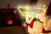 Composite image of santa checking his list — Stock Photo