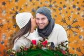Composite image of winter couple holding gift — Stock Photo