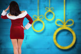 Composite image of rear view of sexy santa girl — Stock Photo