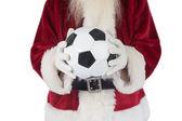 Santa holds a classic football  — Стоковое фото
