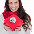 Happy brunette holding red gift with a bow — Stock Photo #57250539