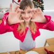 Festive little girl making christmas cookies — Stockfoto #57250759