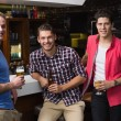 Young men drinking beer together — Stock Photo #57251725