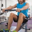 Man using resistance band in gym — Stock Photo #57252013