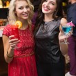 Pretty friends drinking a cocktail — Stock Photo #57252079