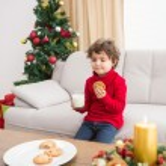 Festive little boy having milk and cookies — Stock Photo #57252119