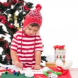 Festive little boy drawing pictures — Stock Photo #57252651