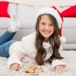Festive little girl eating cookies — Stock Photo #57252875