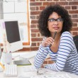 Thoughtful female photo editor in office — Stock Photo #57252895