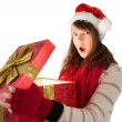 Young woman opening a glowing christmas gift — Stock Photo #57253583