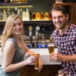 Young couple having a drink together — Stock Photo #57254633