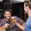 Young men drinking beer together — Stock Photo #57255371