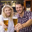 Young couple having a drink together — Stock Photo #57256325