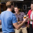 Young men drinking beer together — Stock Photo #57256661