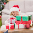 Cute little girl surrounded by christmas gifts — Stock Photo #57256721