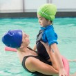 Cute little boy learning to swim with coach — Stock Photo #57257211