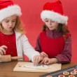 Festive little girls making christmas cookies — Stockfoto #57257407