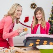 Festive mother and daughter making christmas cookies — Stock Photo #57257467