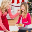 Festive mother and daughter making christmas cookies — Stock Photo #57258797