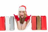 Happy woman lying between shopping bags — Foto Stock