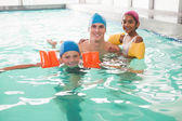 Cute swimming class in pool with coach — Foto Stock