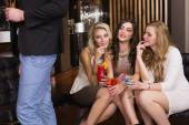 Pretty friends checking out the boys — Stock Photo