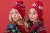 Festive little girls under a blanket — Stock Photo