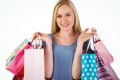 Pretty young blonde holding shopping bags — Stock Photo