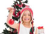 Festive little girl holding christmas bauble — Stock Photo