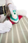 Santa claus ironing his hat — Photo